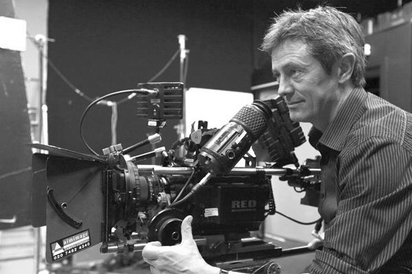 professional cameraman with full kit